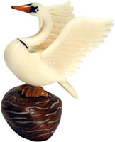 Detailed tagua nut swan with wings raised.
