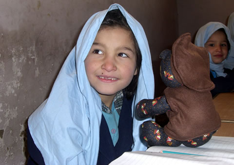 Afghan girl after receiving a teddy bear at her school in Kabul, Afghanistan.