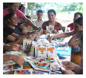Nicaraguan women creating dyed corn leaf greeting cards.