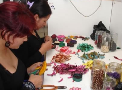 Two women are hard at work creating your orange peel jewelry.