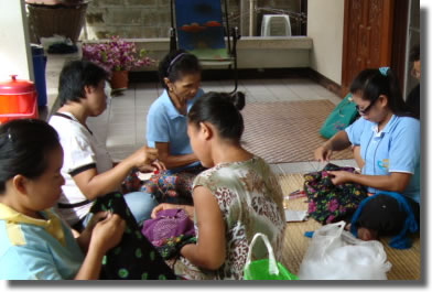 Women in Thailand crafting Christmas Ornaments.