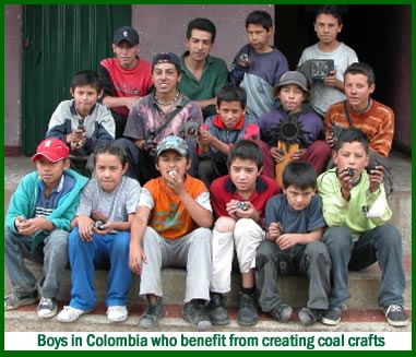 Colombian boys on steps - coal crafts keep them out of unsafe coal mines.
