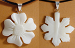 tagua flower and leaf pendants from Ecuador.