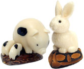 tagua nut pig with piglets and tagua nut rabbit.