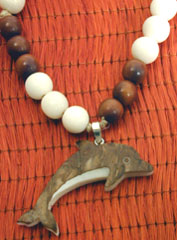 Dolphin tagua nut necklace kit.