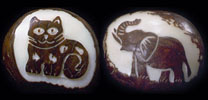 cat and elephant etched on a whole tagua nut.