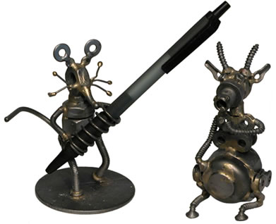 Recycled metal mouse pen holder and a recycled metal goat sculpture.
