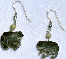 hand-carved tagua nut frog earrings.