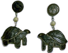 Turtle tagua nut pin from the rainforests.