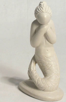 Haitian carved soapstone mermaid.