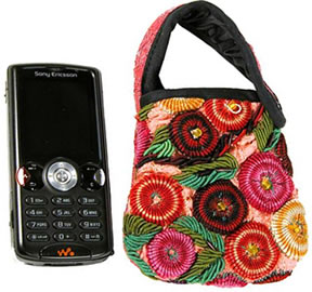 Handcrafted Guatemalan cell phone holder, with fun flowers.