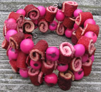 Pink with Red orange peel and acai seed bracelet from Colombia.