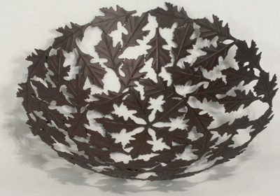 Oak Leaf bowl crafted in India from recycled metal. Fair trade.