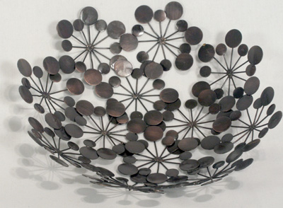 Star Burst bowl crafted in India from recycled metal. Fair trade.