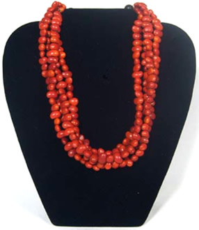 4 strands of bright red Colombian seeds make up this necklace.