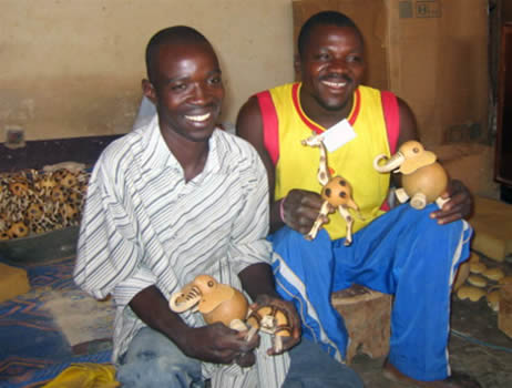 Group leaders of disabled men who carve and decorate these gourd bobble-head animals in Burkina Faso.