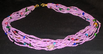 Purple multi-strand glass bead necklace from Kenya, Africa.