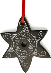 Star Christmas tree ornament crafted from Coal in Colombia to keep kids out of coal mines.