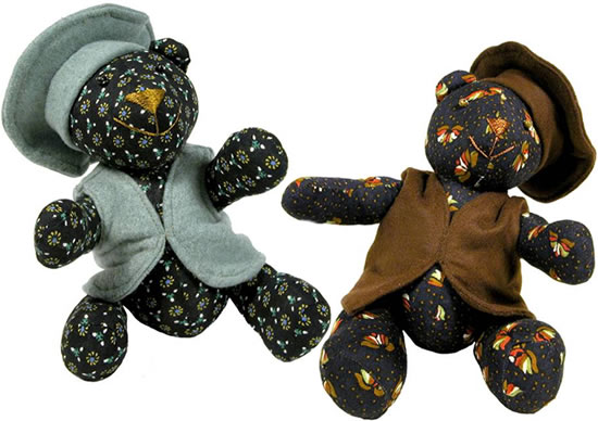 Afghan teddy bears - 2 cotton bears with floral patterns.