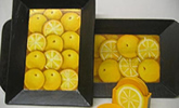 Lemons decorate these wooden trays from El Salvador.