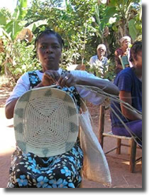 Haitian woman weaving.
