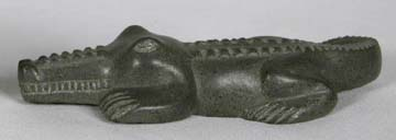 Haitian carved soapstone alligator.