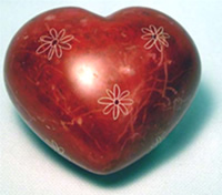 Reddish pink soapstone heart with flowers.