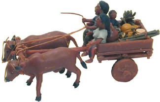 Bullock Cart with family and supplies created from balata from bulletwood trees without damaging the tree.