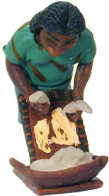 You can help save the rainforests in Guyana by purchasing this Woman Grating Cassava figurine.