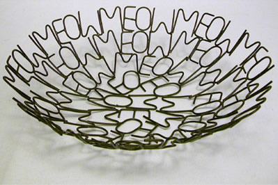 Cat Meow bowl crafted from metal in India. Fair trade.