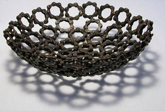 Recycled bicycle chain metal bowls crafted in India.