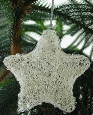 Clear beads with white wire star Christmas Ornament from India.