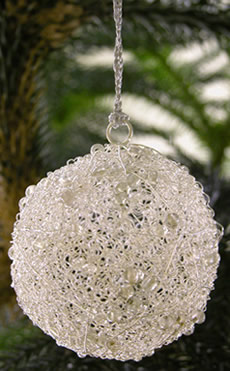 Clear beads with white wire sphere Christmas Ornament from India.