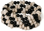 coiled white bean and chirilla seed bracelet - from Colombia.