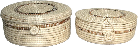 Sisal round baskets with hinged covers from Haiti.