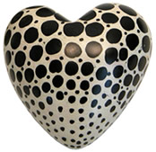 soapstone heart - white with varying size black dots from Kenya.